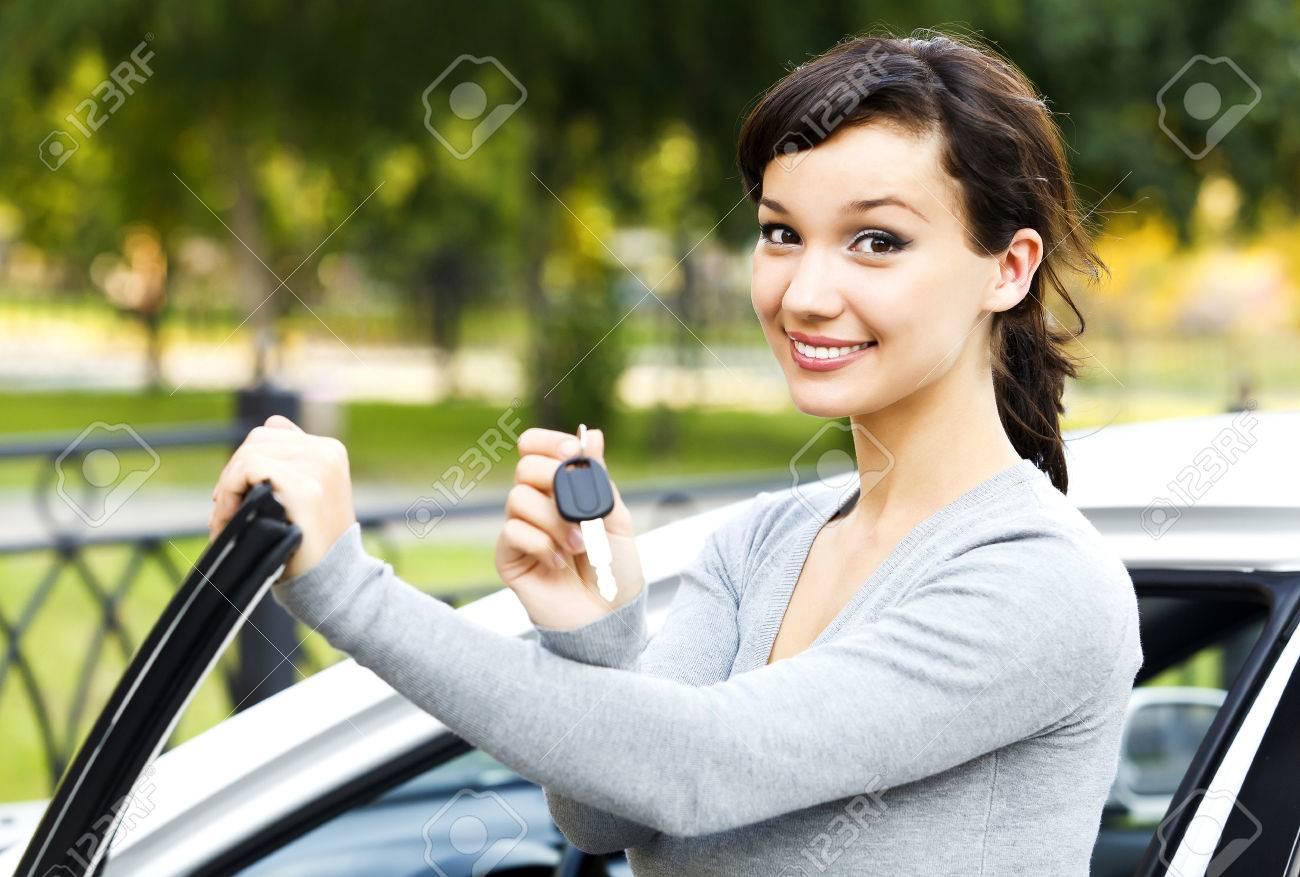Pretty girl showing the car key - 43375221