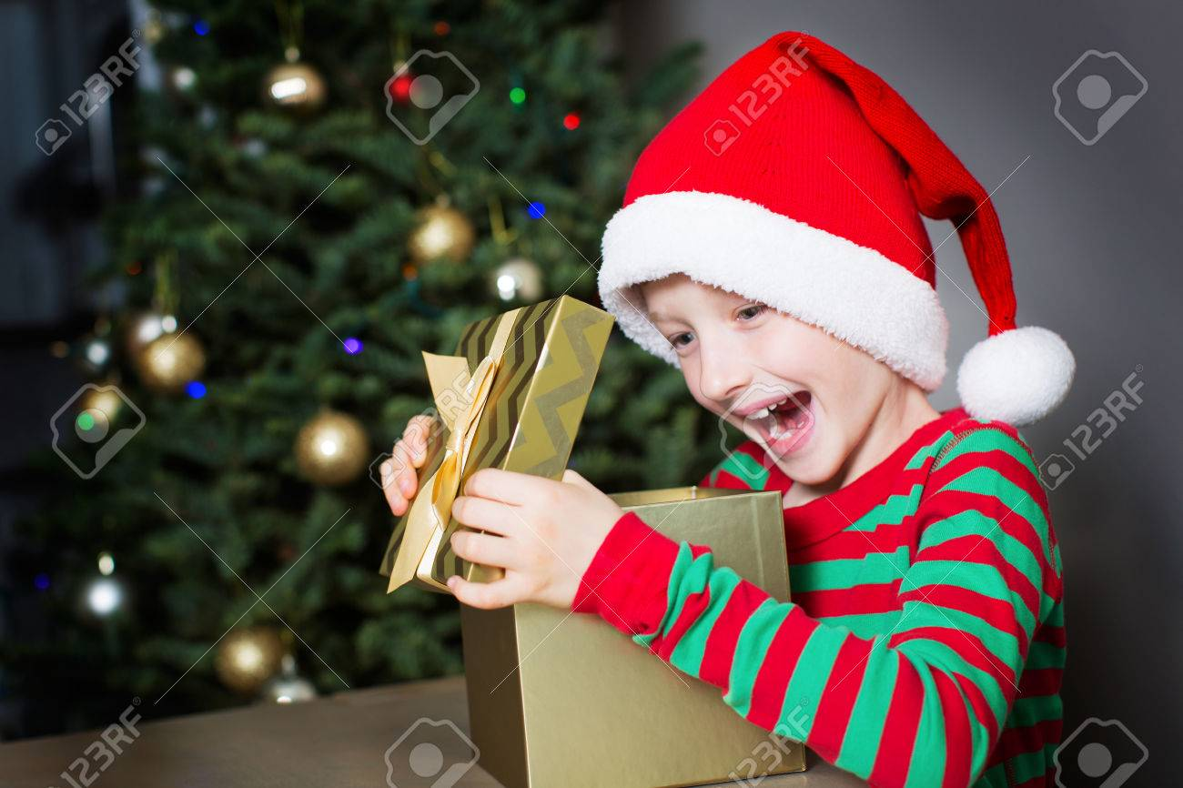 Image result for boy opening a present