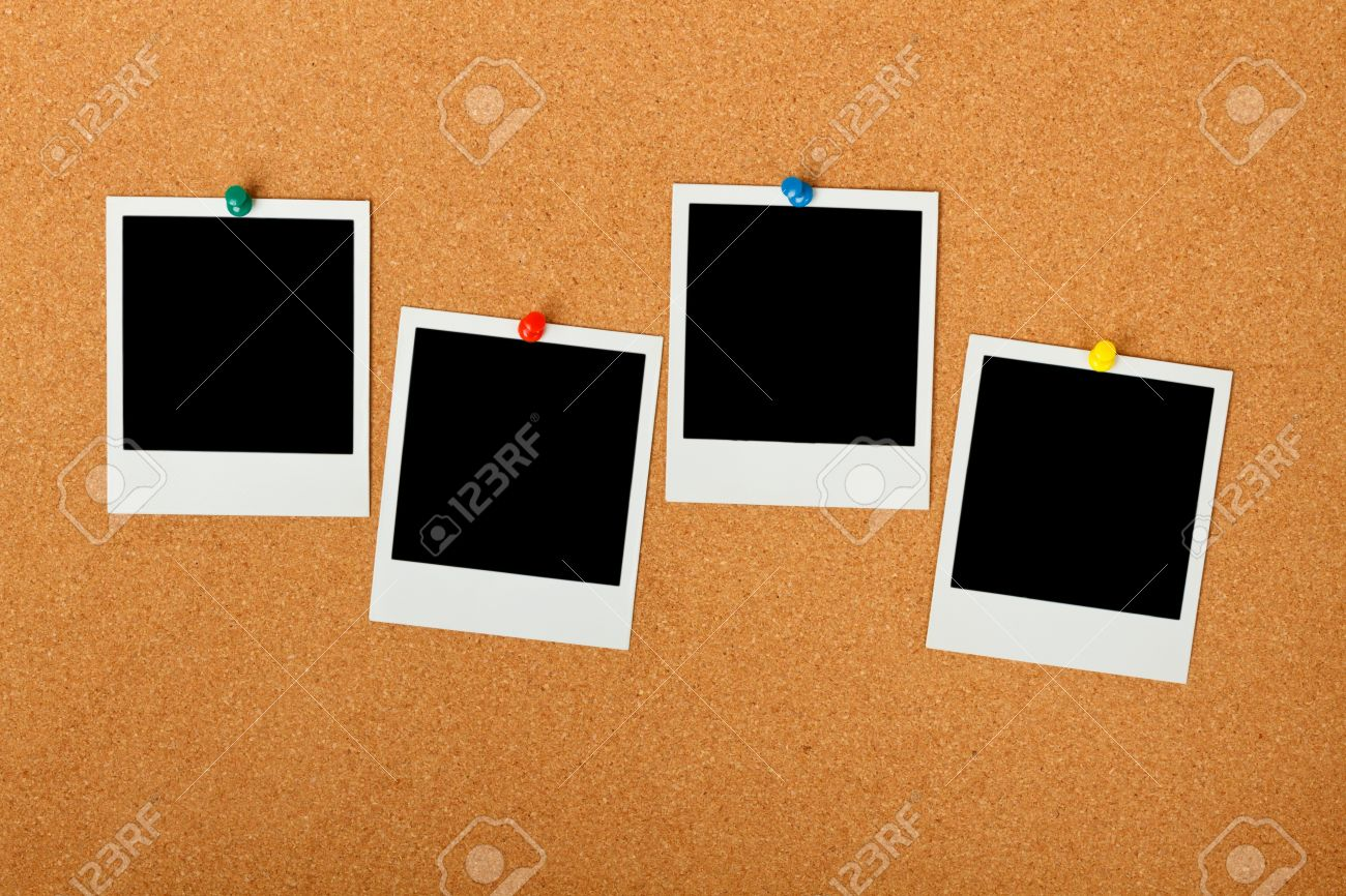 cork bulletin board with blank instant print pictures stock photo