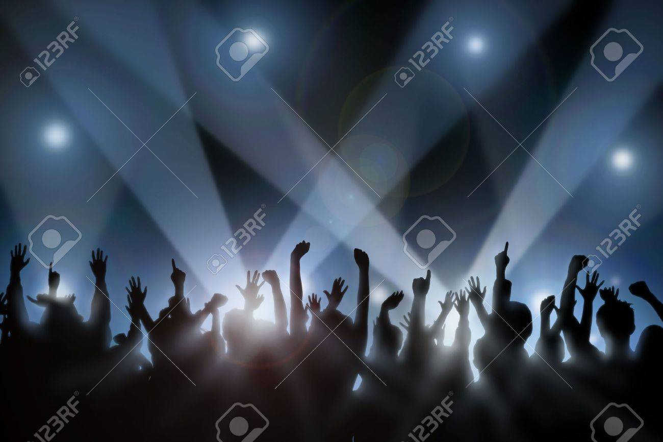 Fans raise their hands at a concert Stock Photo - 1738452