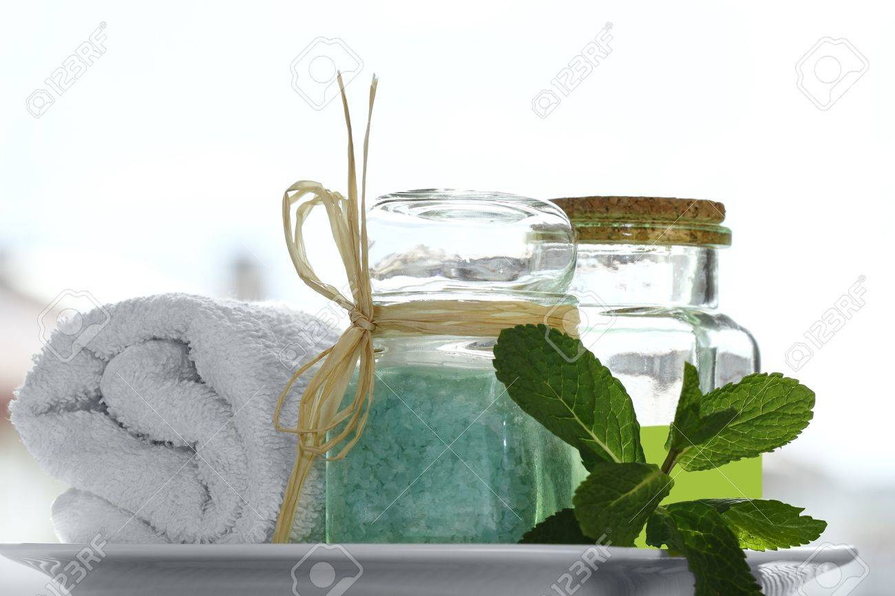Spa collection with white towel, bath salt, massage oil, mint, isolated on white Stock Photo - 13384307
