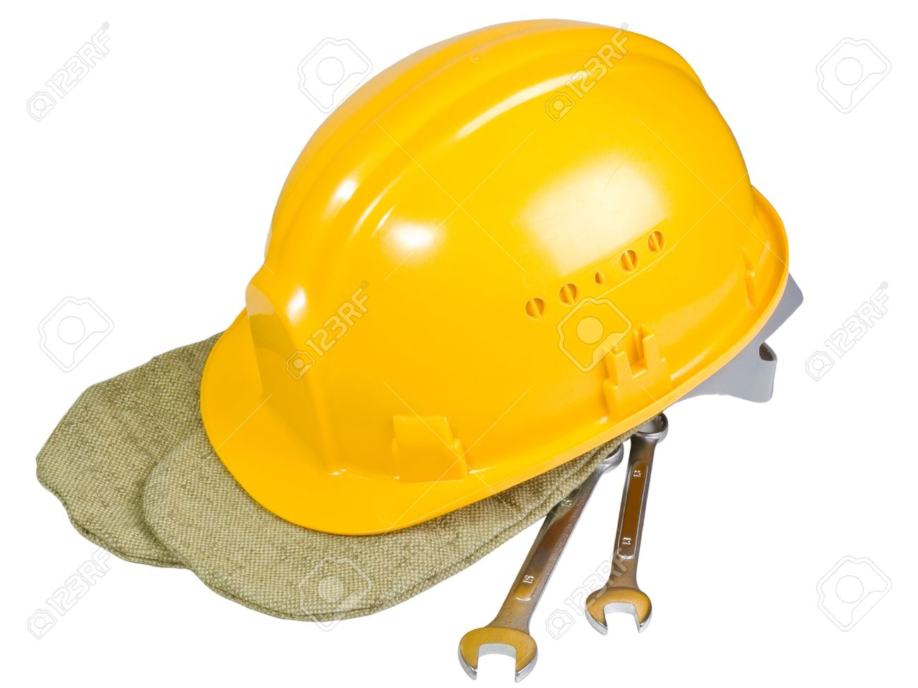 Yellow helmet, mittens, instrument for work Stock Photo - 4674529