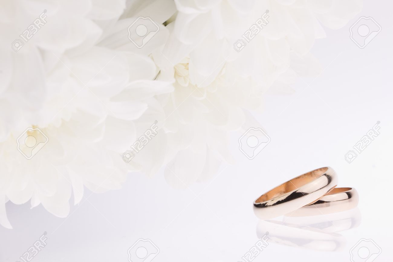 Wedding rings flowers  White Flowers And Gold Wedding Rings Stock Photo, Picture And ...