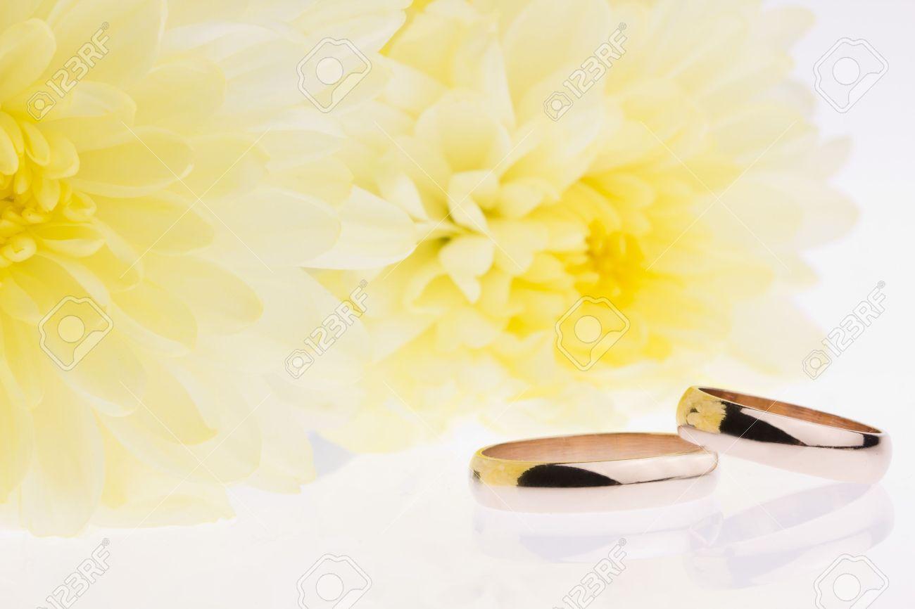 Yellow flowers and gold wedding rings stock photo picture and stock photo yellow flowers and gold wedding rings mightylinksfo