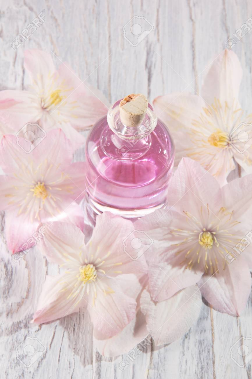 Perfume bottle and fresh white flowers over white stock photo perfume bottle and fresh white flowers over white stock photo 105084238 mightylinksfo