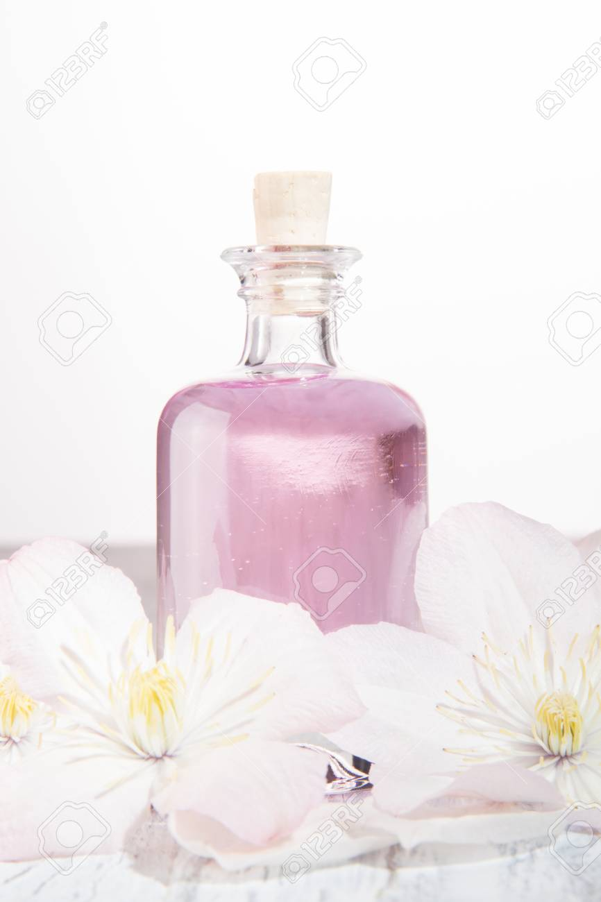 Perfume bottle and fresh white flowers over white stock photo perfume bottle and fresh white flowers over white stock photo 105084408 mightylinksfo