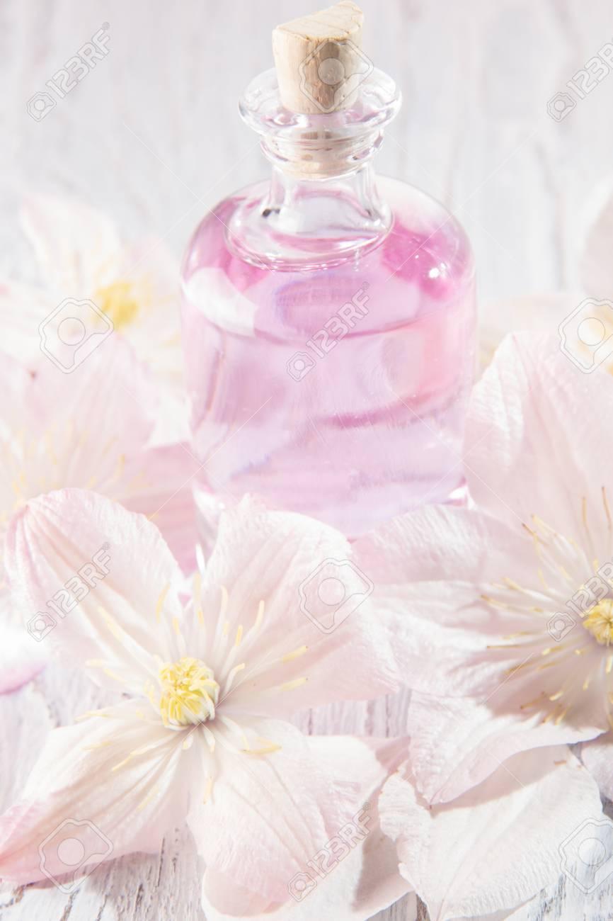 Perfume Bottle And Fresh White Flowers Over White Stock Photo