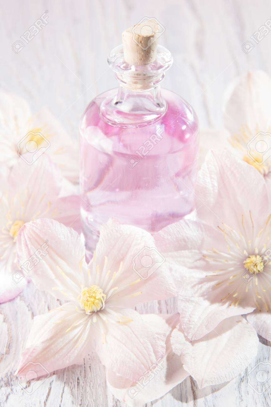 Perfume Bottle And Fresh White Flowers Over White Stock Photo