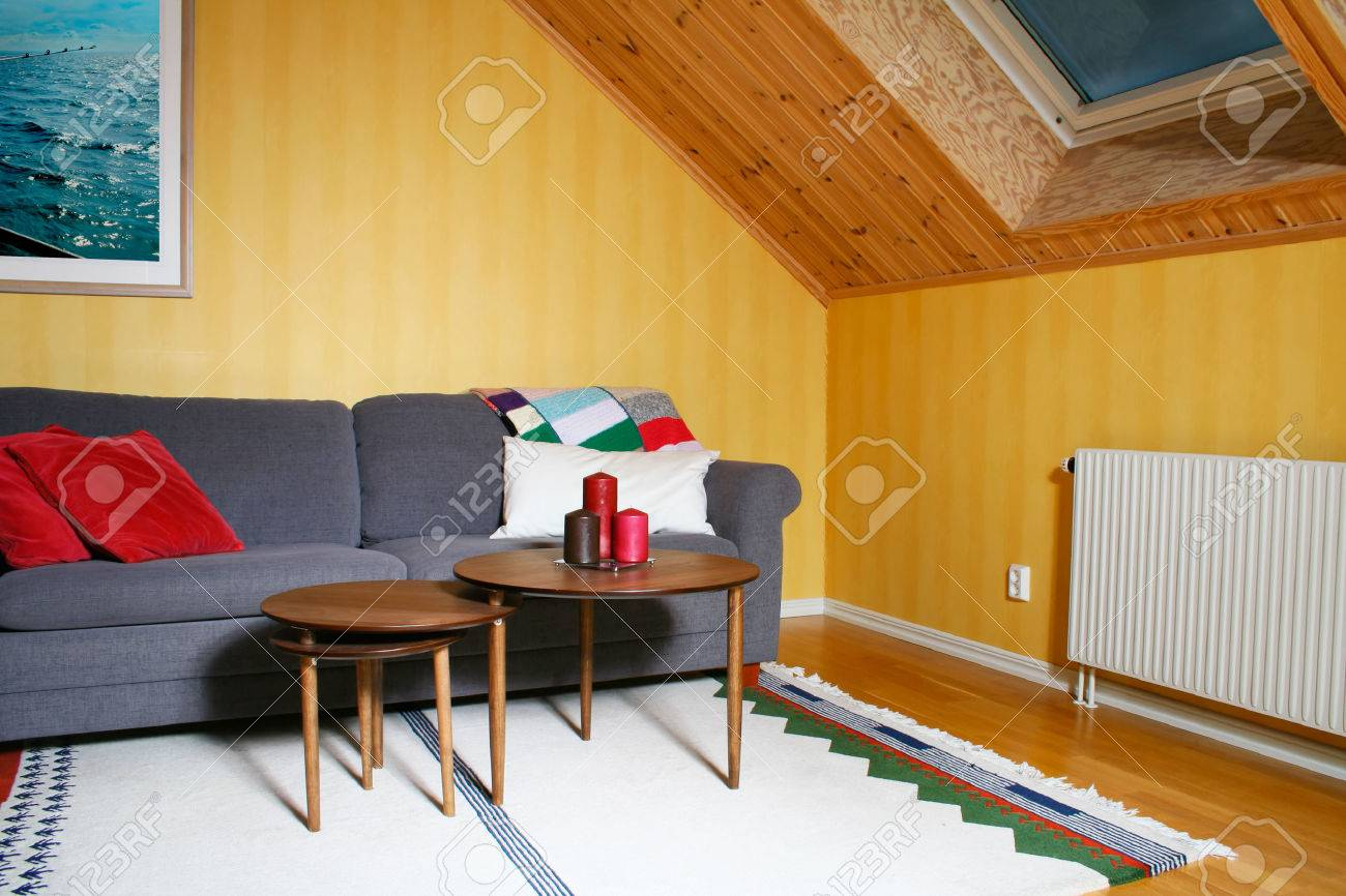 a cozy living room with a roof window and wooden panels on the a cozy living room with a roof window and wooden panels on the ceiling stock photo