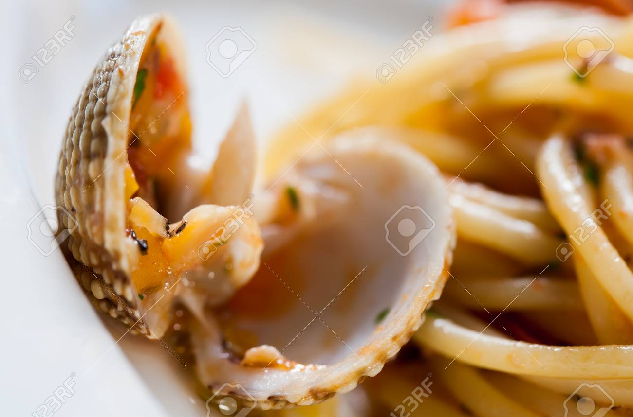 Shell fish breaked open with some potato skins on a plate Stock Photo - 14021914