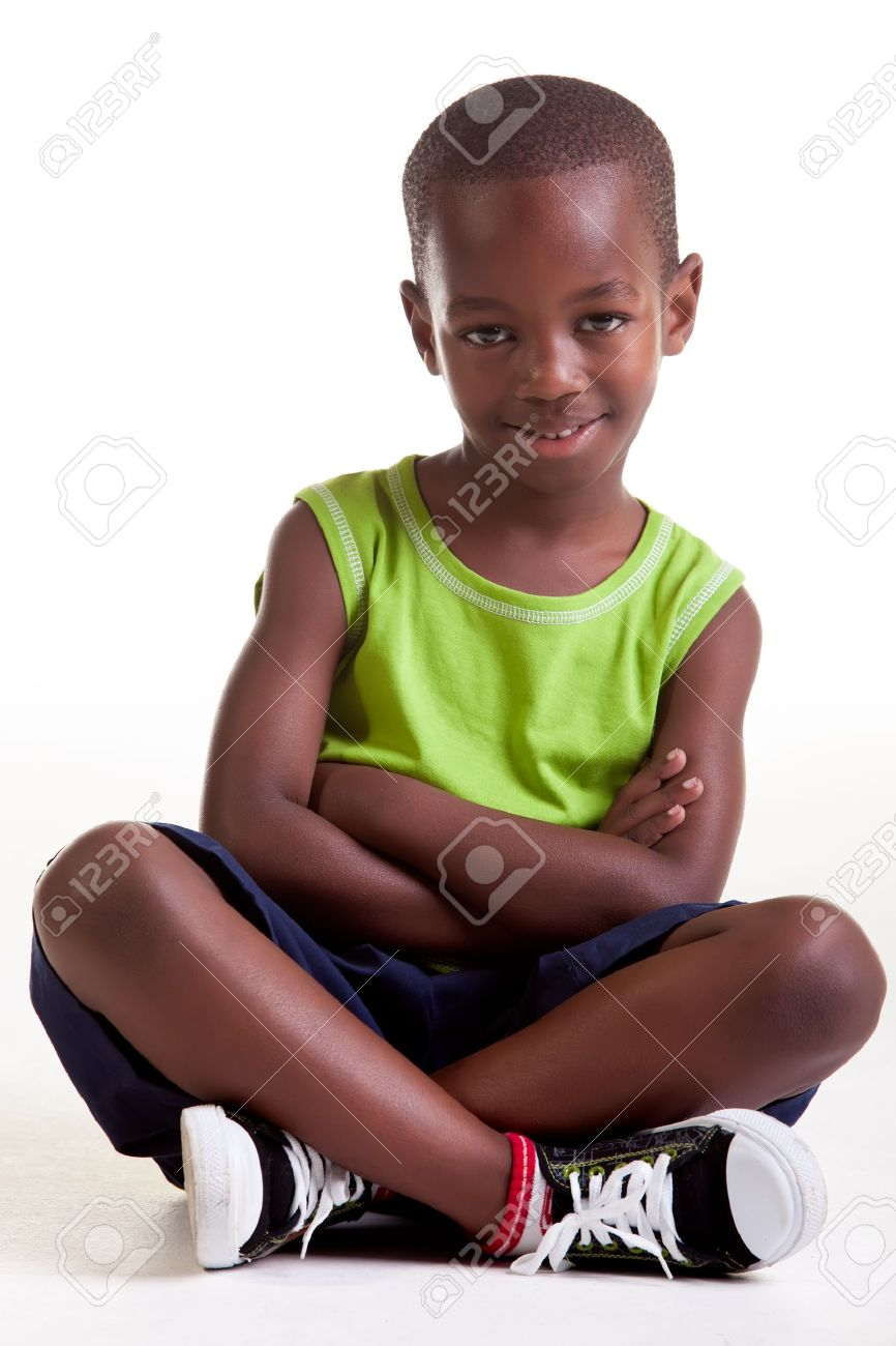 The boy is sitting with a big smile and also with crossed arms and legs Stock Photo - 14563869