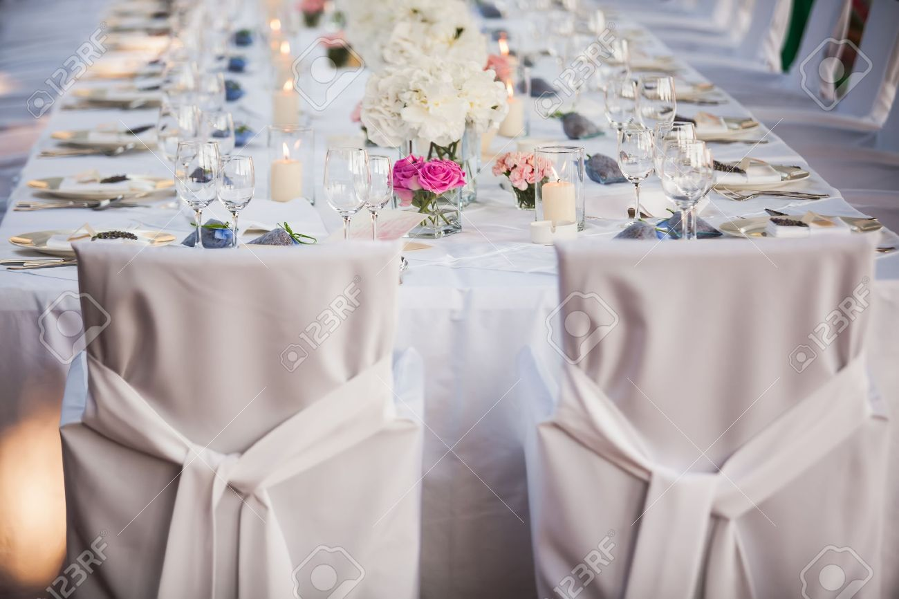Wedding Couple Chairs And Then Follow The Rest Stock Photo - Catering chairs