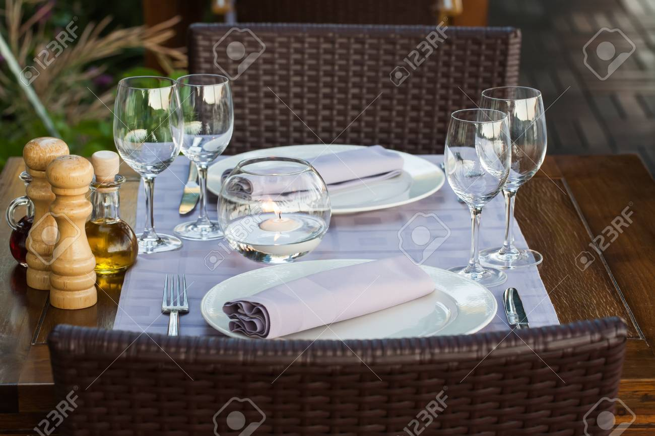 Table Setting For Two People On The Deck Of The Restaurant. Stock ...