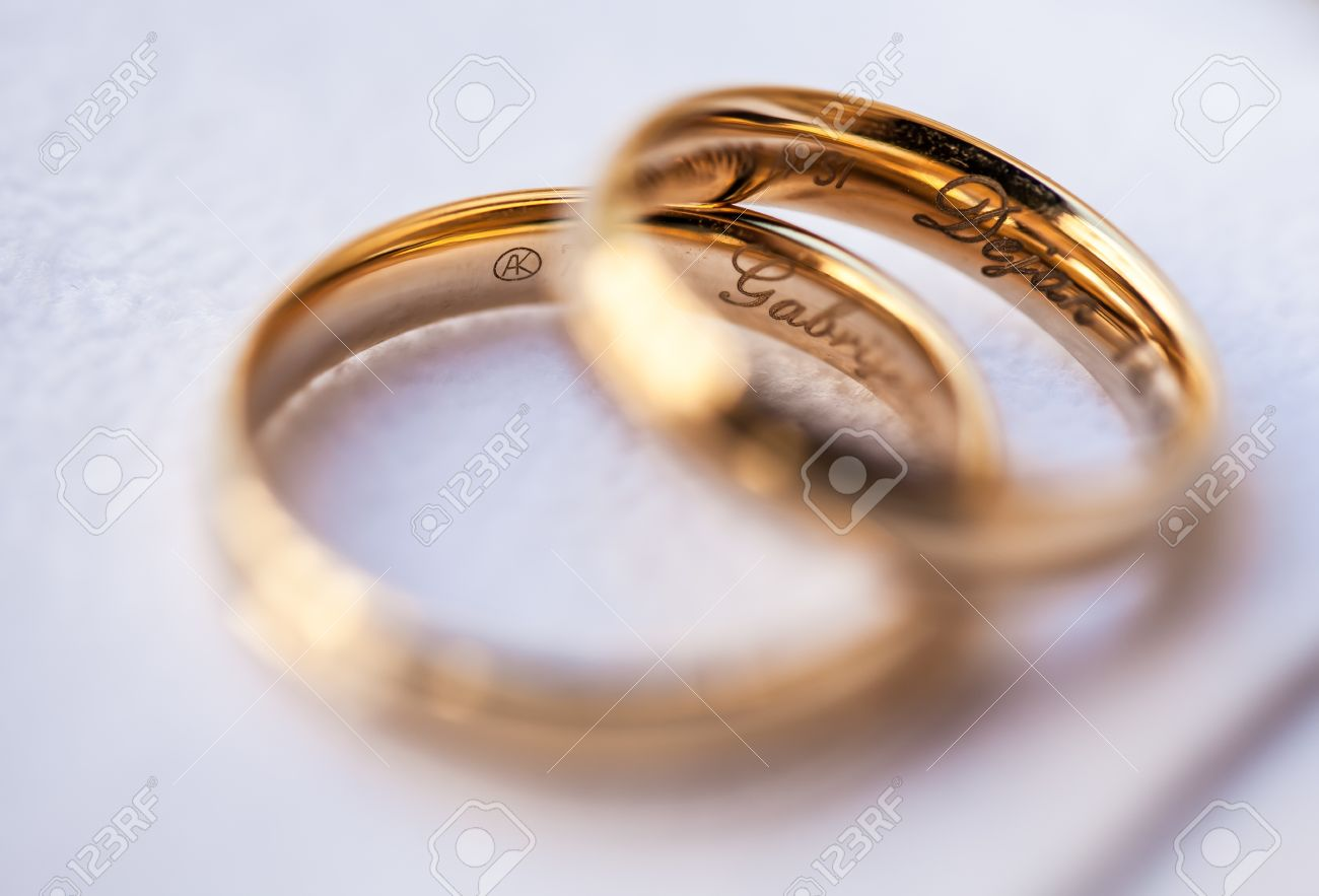 The Couple S Two Wedding Rings Consist Their Name Inside Stock