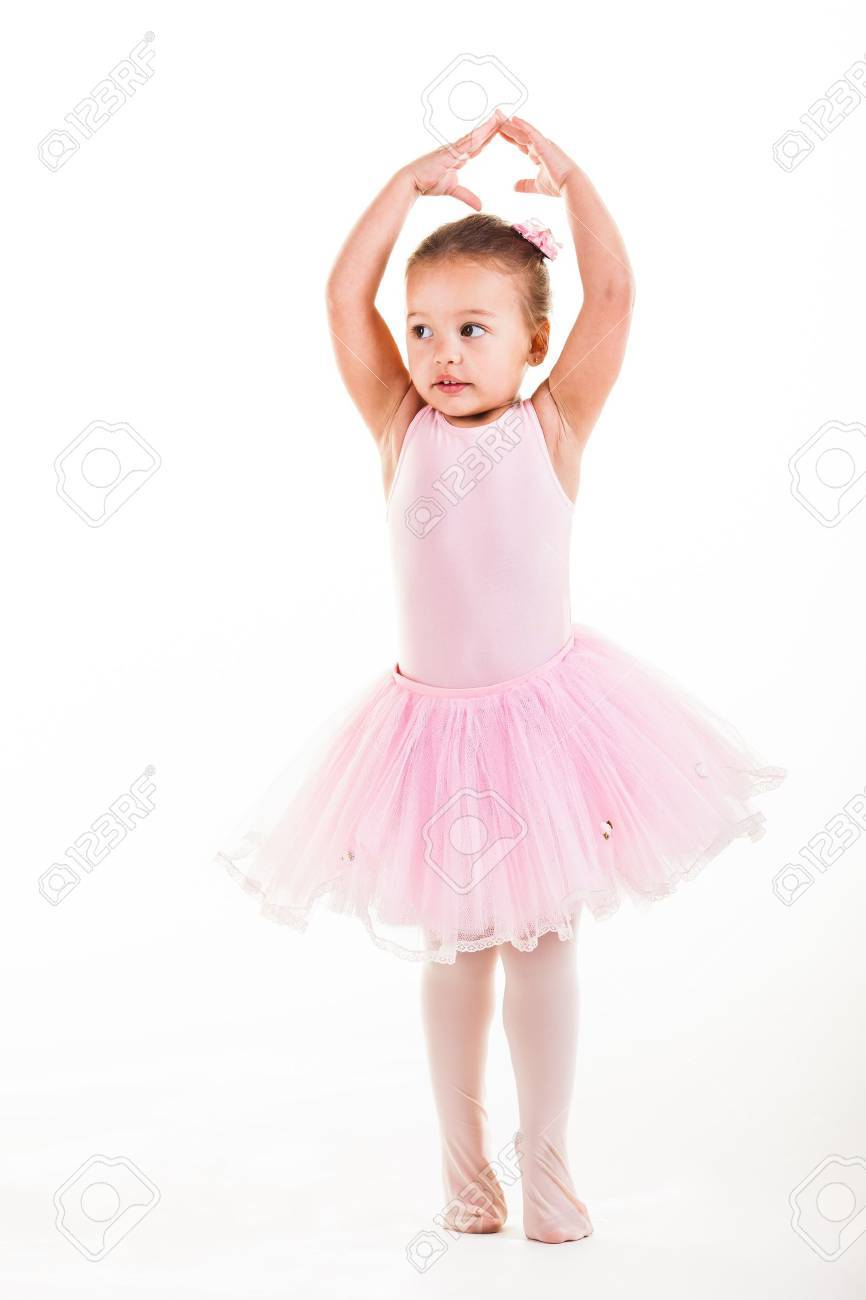 A little pink ballerina in  a playful mood in the studio. Stock Photo - 20077611