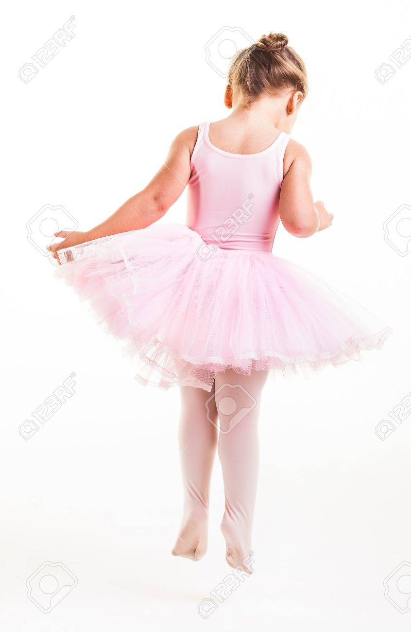 A little pink ballerina in  a playful mood in the studio. Stock Photo - 20077593