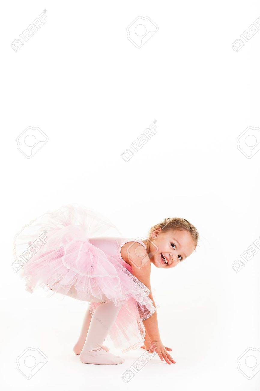 A little pink ballerina in  a playful mood in the studio. Stock Photo - 20077600