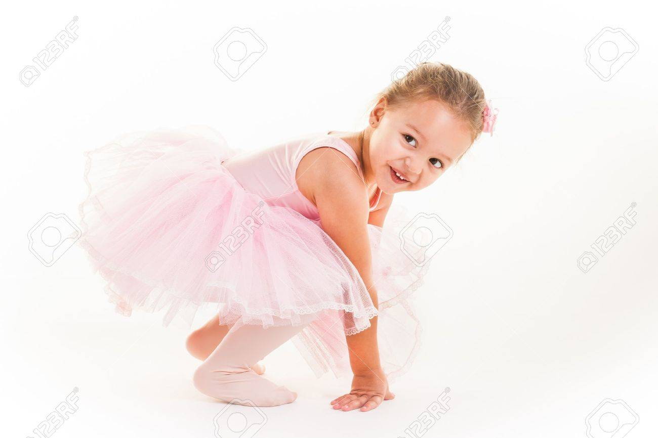 A little pink ballerina in  a playful mood in the studio. Stock Photo - 20077584