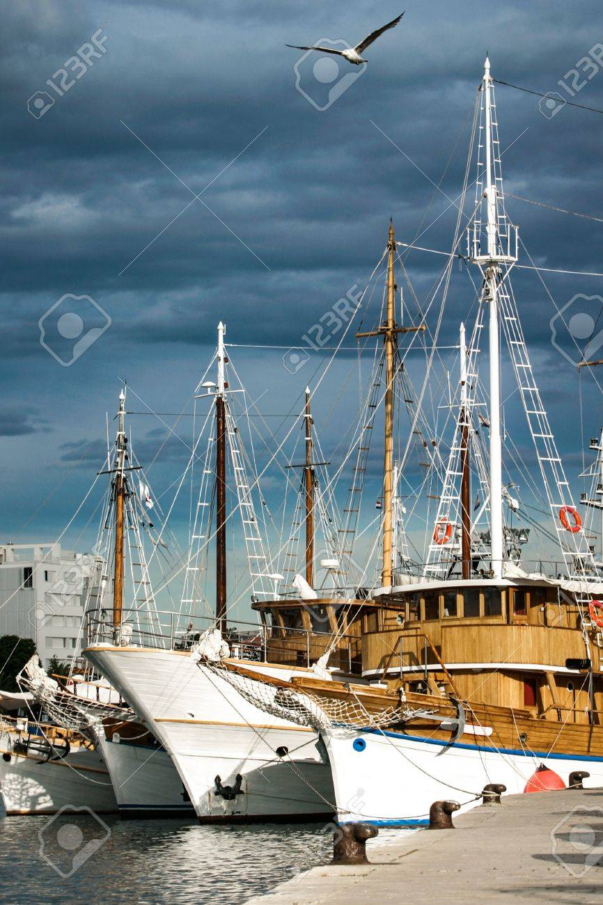 a few wooden boats docked closely together for the night Stock Photo - 20077957