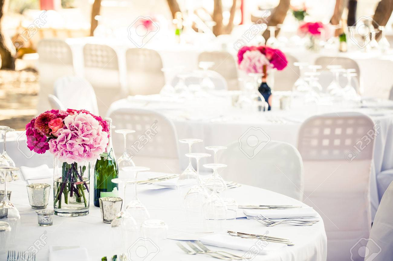 A White Crisp Decorated Table With A Pink Hydrangea Centerpiece ...