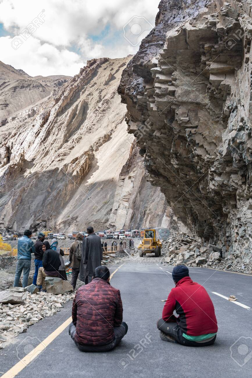 The group of truck drivers waiting when the road will be clear because of landslide - 131977344