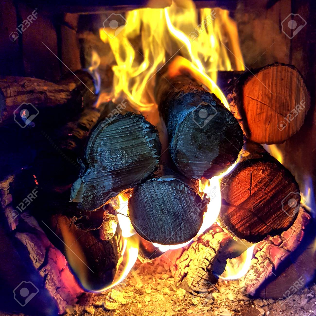 Fire Flame Burning Coal And Wood In Open Fireplace Charred Timber