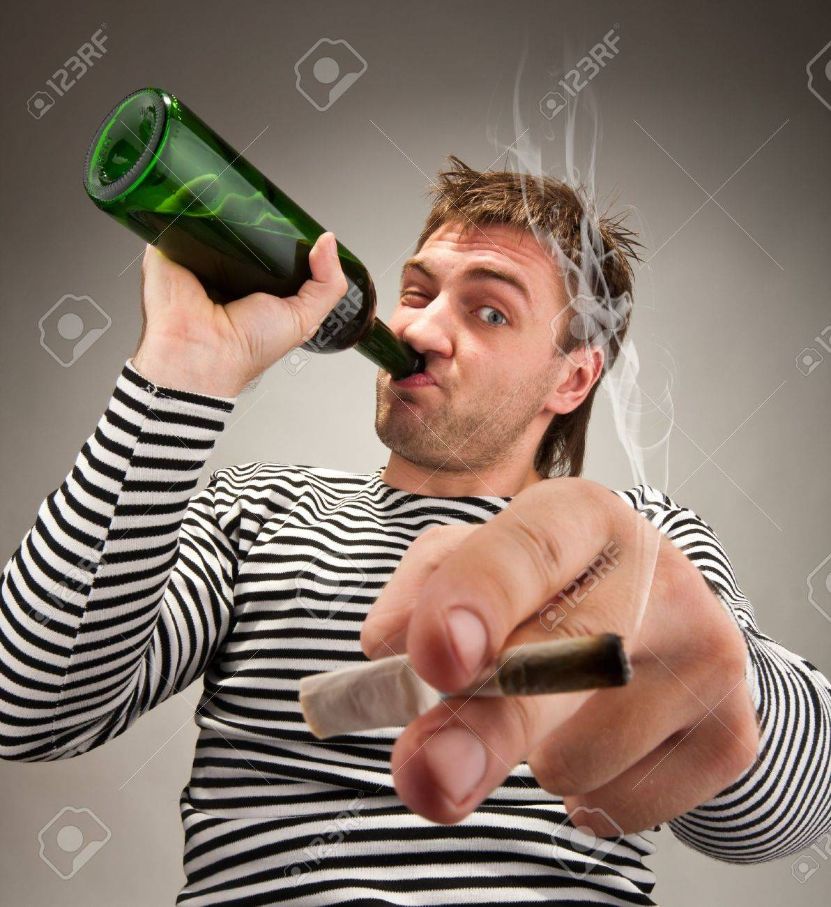Drunk bizarre sailor with bottle and cigarette Stock Photo - 18055846