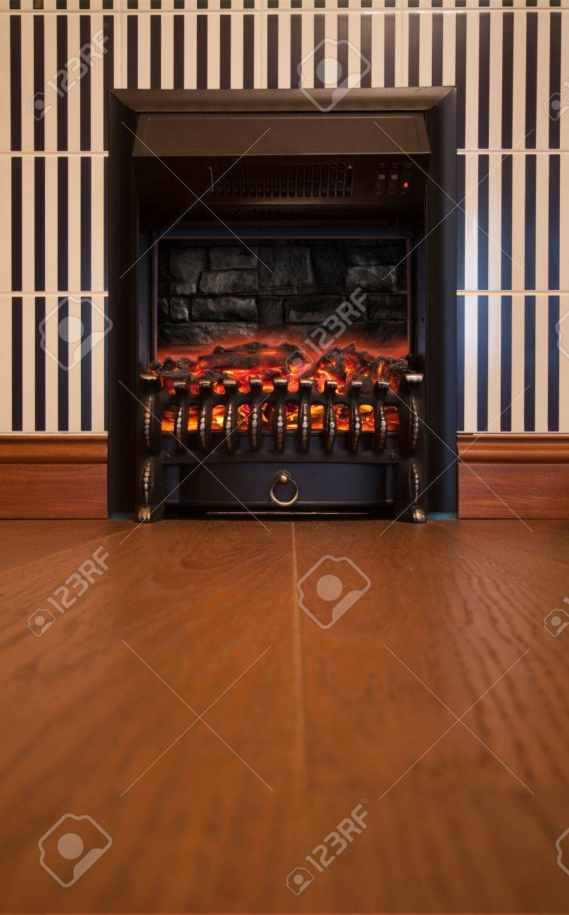 retro interior with electrical fireplace in the wall stock photo