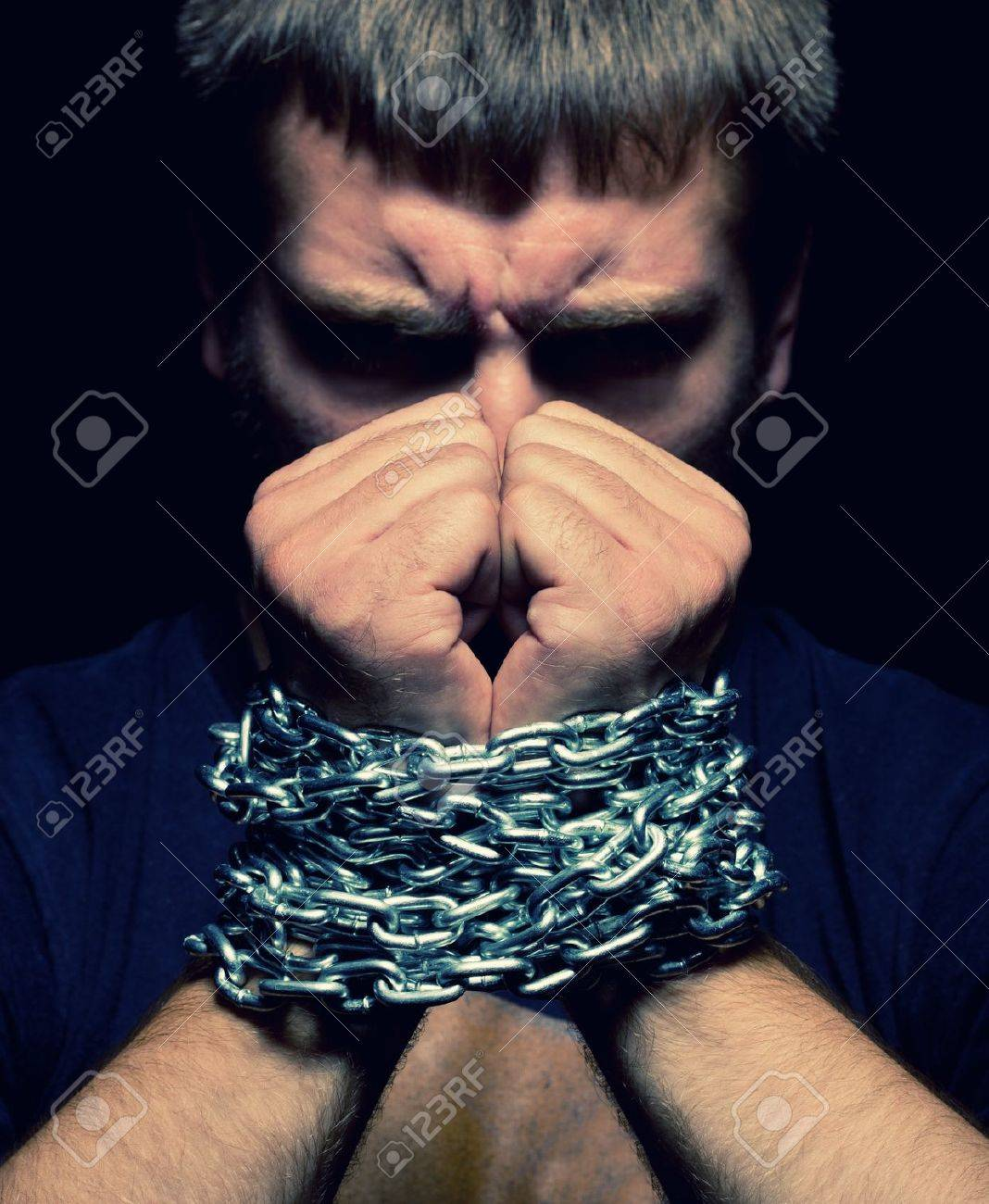 Angry man with chained hands Stock Photo - 18055173