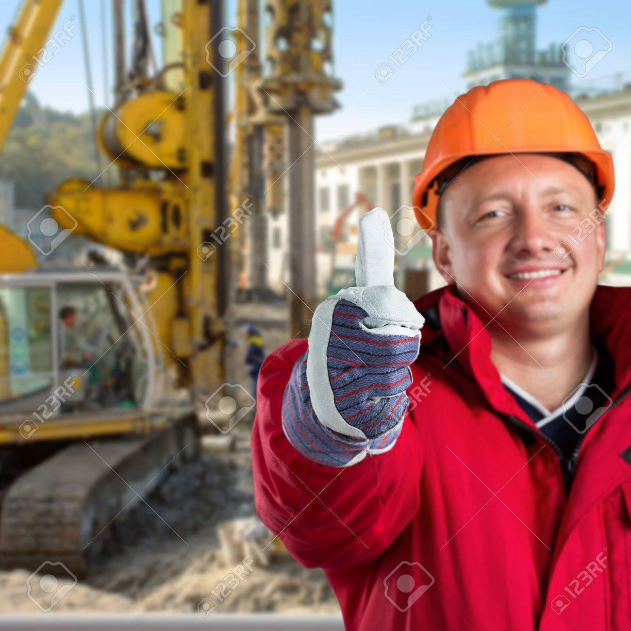 Happy worker against construction site Stock Photo - 18055402