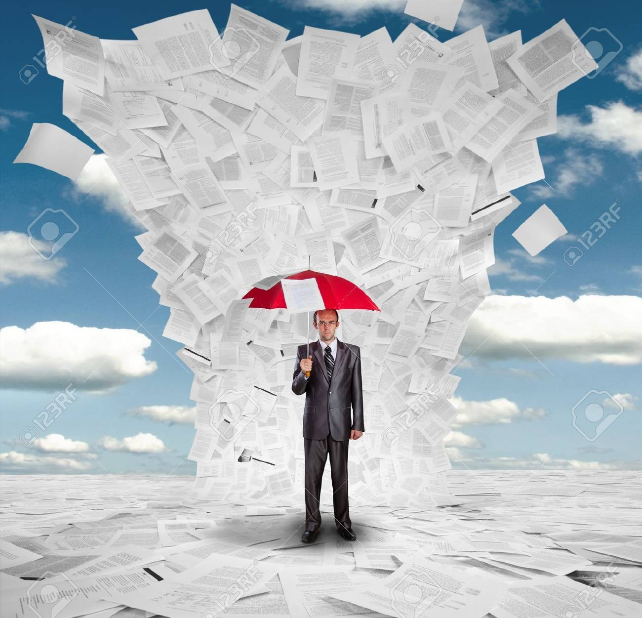 Serious businessman with red umbrella under huge wave of documents Stock Photo - 18072299
