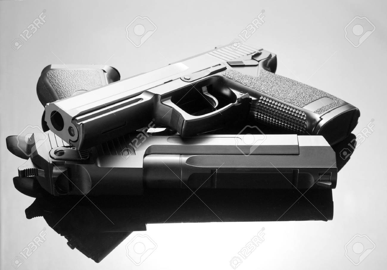 Two handguns. Desert Eagle and M23 Double Eagle Stock Photo - 18071902