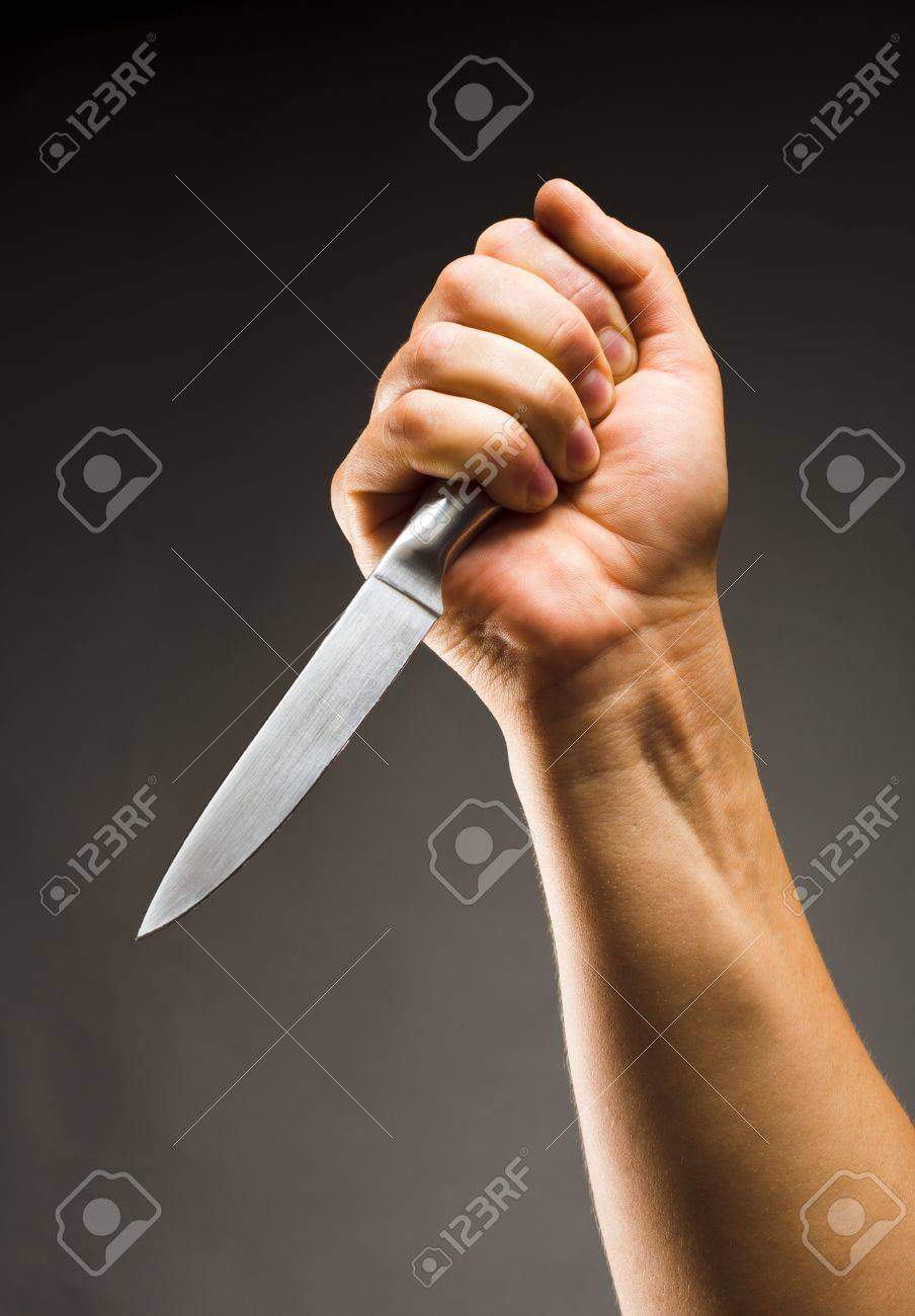 Close-up of hand with knife Stock Photo - 18104493