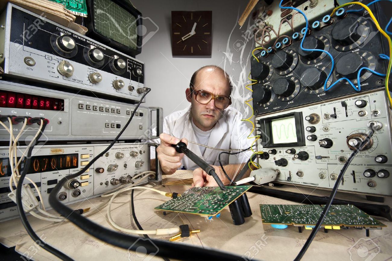 Funny nerd scientist soldering at vintage technological laboratory Stock Photo - 18104010