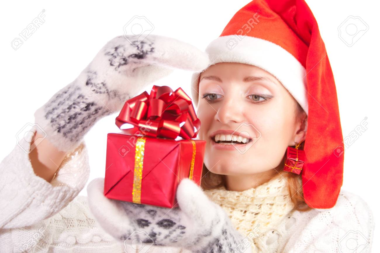 Happy smiling woman in christmas hat and mittens with gift. Isolated on white Stock Photo - 18103424