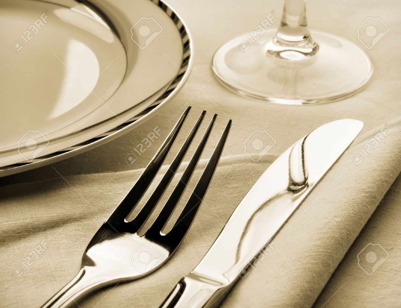 Dinner Setting dinner set. fork and knife on napkin. sepia toned stock photo