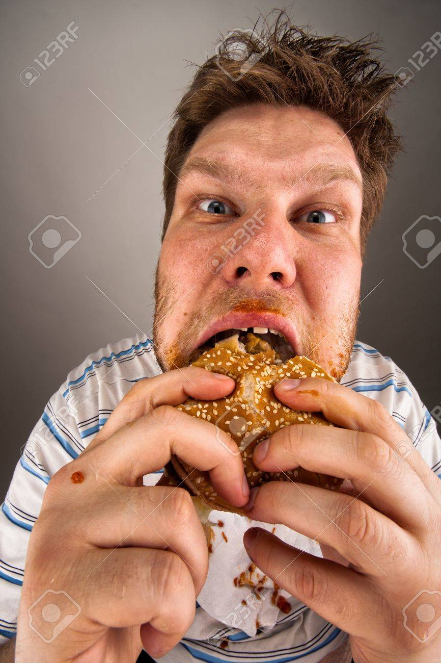 Portrait of expressive fat man chewing hamburger Stock Photo - 18303352