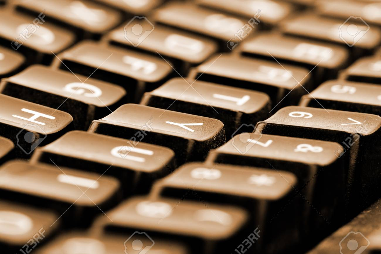 Close-up of computer keyboard. Toned in sepia Stock Photo - 18312408