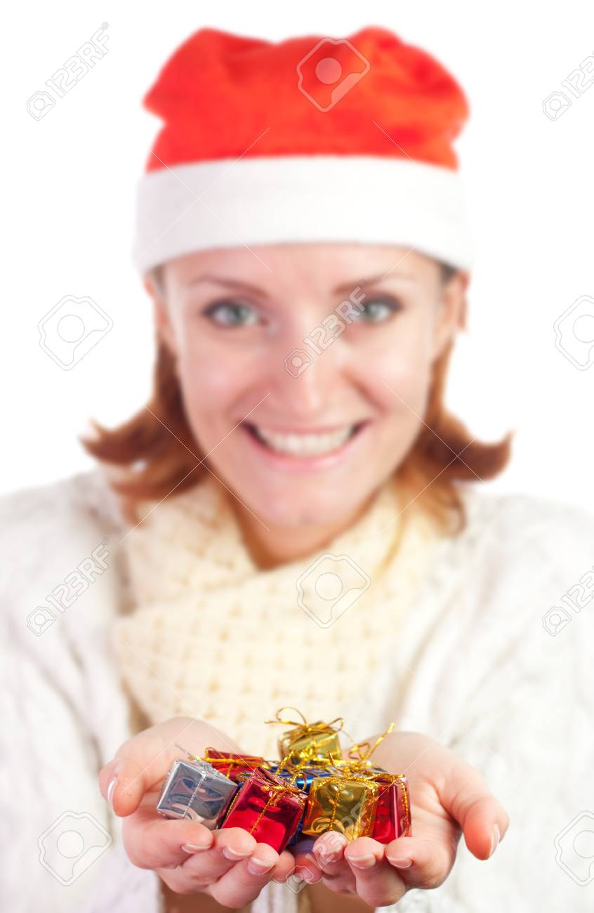 Happy smiling woman in christmas hat with small gifts. Isolated on white Stock Photo - 18341958