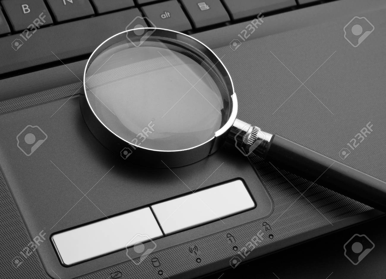Magnifying glass on laptop computer Stock Photo - 18364777