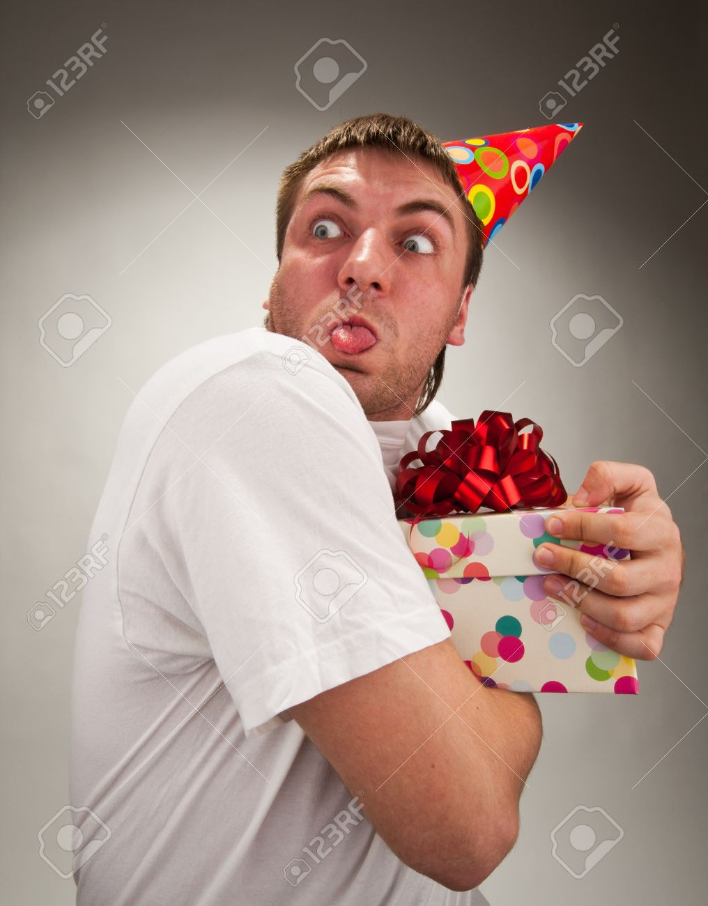 Funny Birthday Man With Gift Making Face Stock Photo Picture And