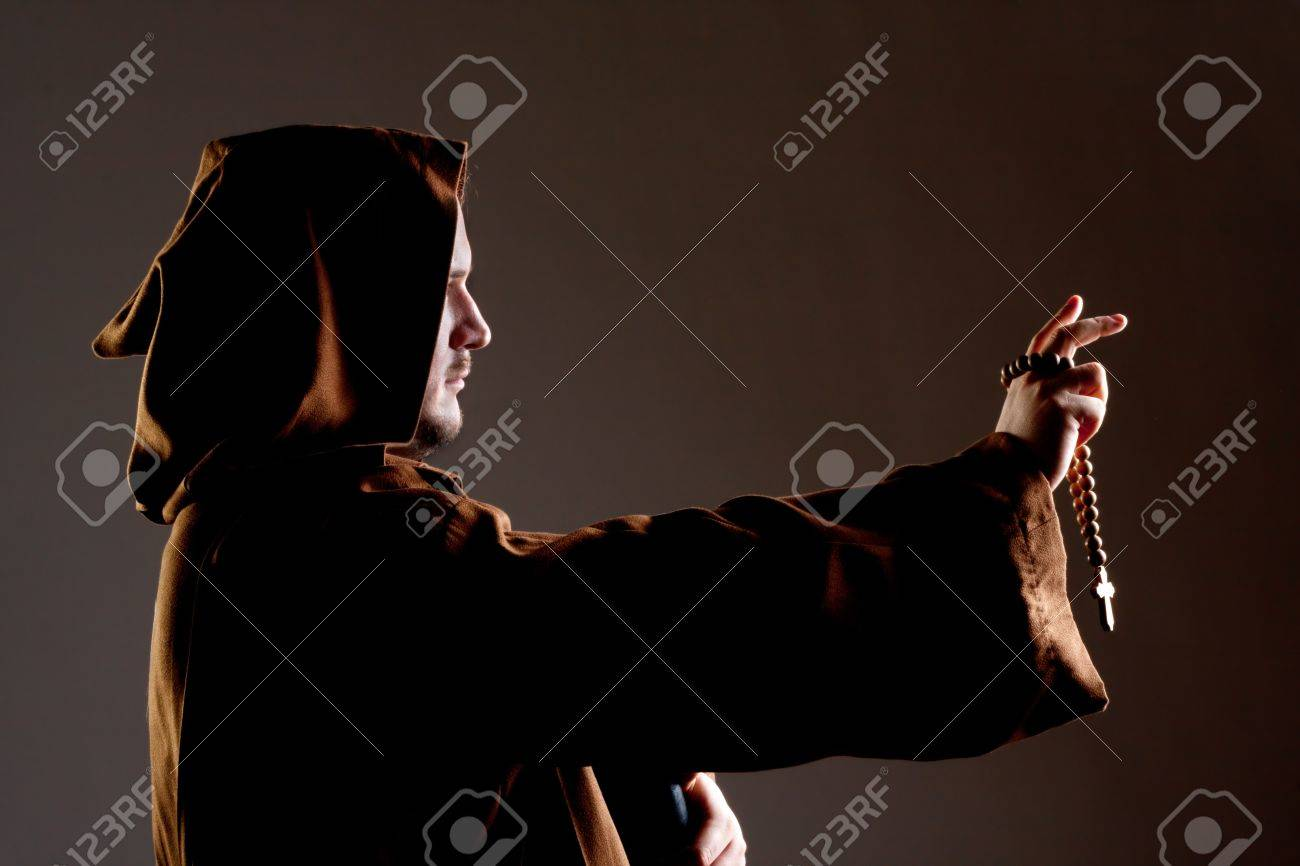 Portrait of preaching medieval monk with wooden rosary Stock Photo - 18426979