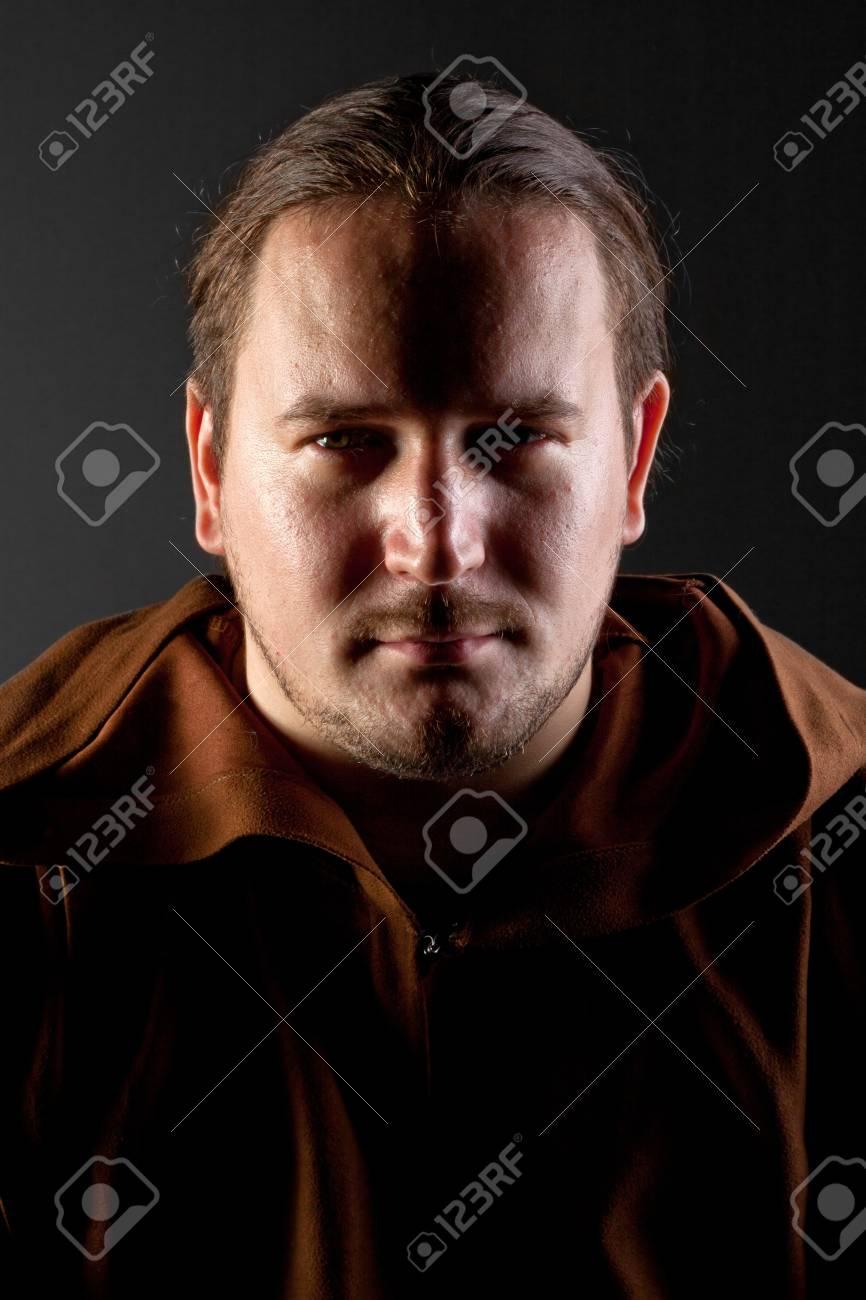 Portrait of pensive monk in the dark Stock Photo - 18481074