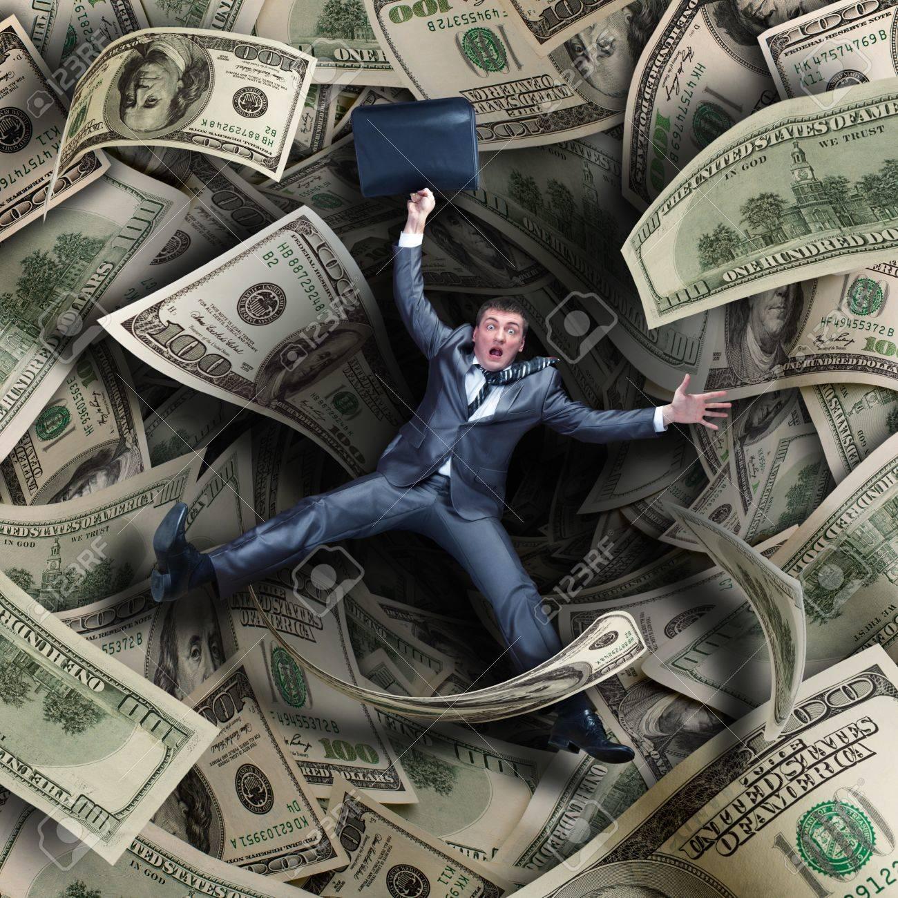 Businessman falling into tunnel of $100 dollar bills - 20310312