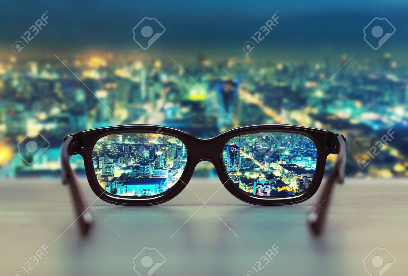 f43d69e6a7 Night cityscape focused in glasses lenses. Vision concept Stock Photo -  32264958