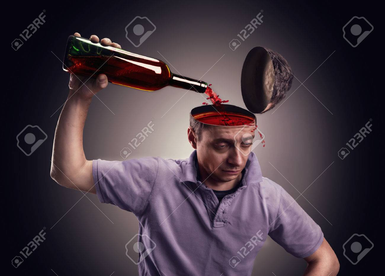 Man pours his head on with alcohol over gray Stock Photo - 38531668