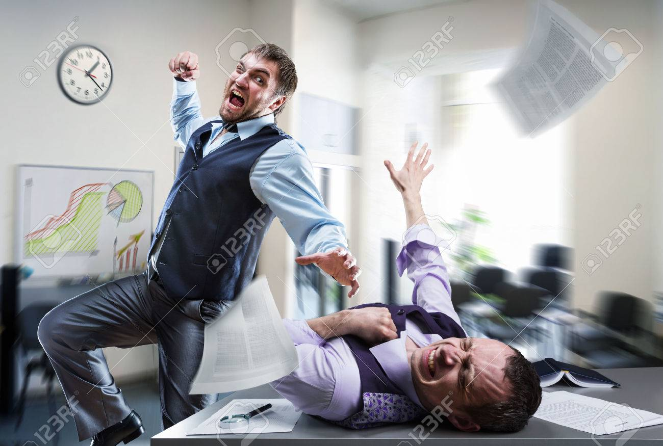 Two agressive businessmen fighting in the office - 38531910