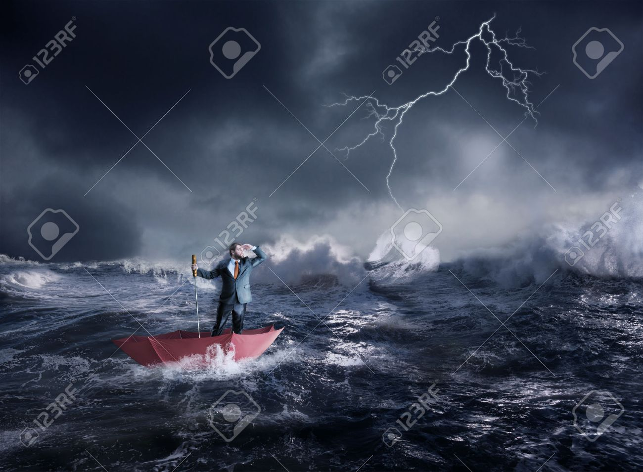 Businessman in the umbrella sails in storm in the night Stock Photo - 38834742