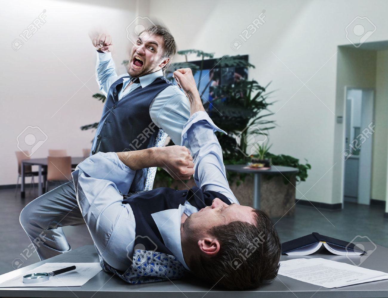 Two furious businessmen fighting in the office Stock Photo - 39184919