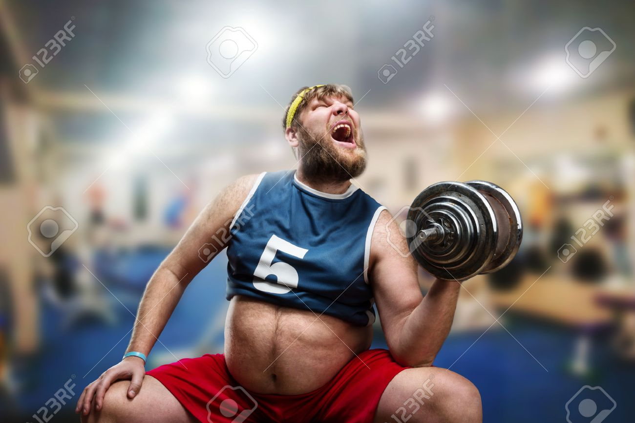 Fat man do hard exercises with a dumbbell in the gym Stock Photo - 40117203